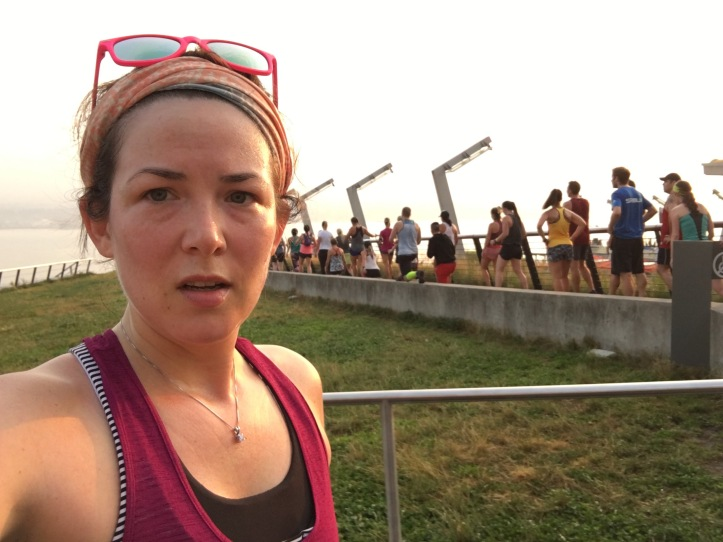 Jessica selfie with people working out in the background at sunrise