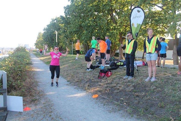 Jess crosses the finish line at a 5k race.