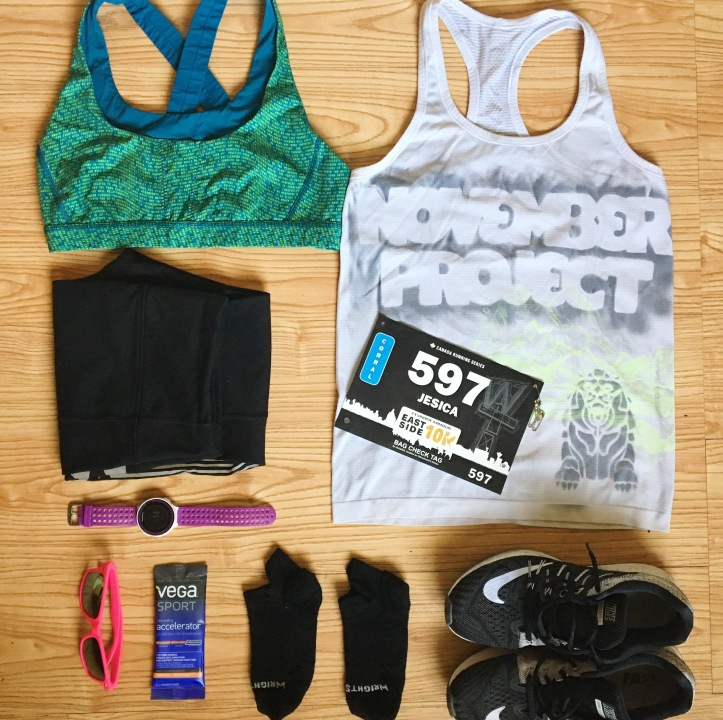 Flat lay of running gear and a race bib.