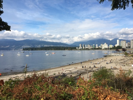 Kitsilano beach with sailboats on the water.